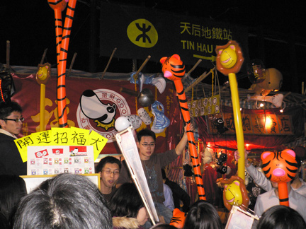 Hawkers selling inflatable animal staffs?