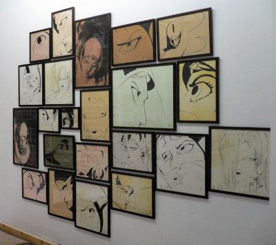 Smaller panels featuring ink on paper